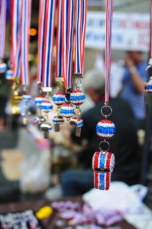 shutdown: BANGKOK THAILAND - FEBRUARY 9, 2014   Whistles and national flag tri-coloured ribbons, Tools and or souvenirs of  Bangkok Shutdown  protest  At Sala Daeng intersection