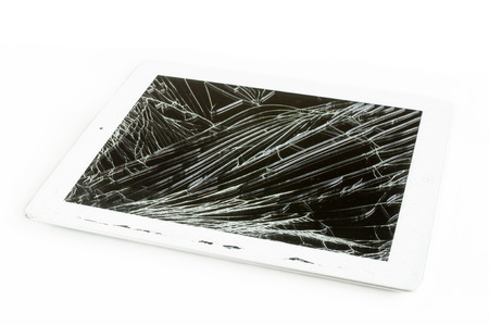 tablet computer with broken glass screen isolated on white background photo