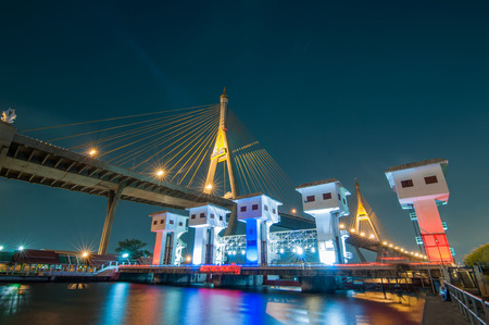 The Bhumibol Bridge  also known as the Industrial Ring Road Bridge  and Klong Lad Pho sluice gate at night, Bangkok, Thailand