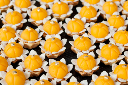 JaMongkut is a kind of crown-like yellow pastry mainly made of yolk and sugar photo