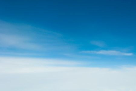 cloud drift: defocused abstract clouds and blue sky background