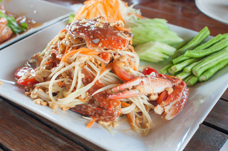 thai papaya salad with fresh horse crab photo
