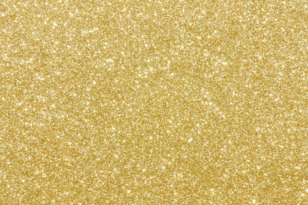 gold yellow: golden glitter texture christmas background Stock Photo