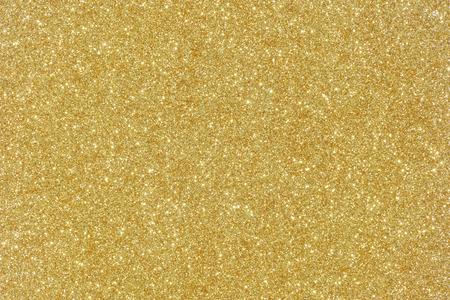 Textura de oro del brillo de Navidad resumen de antecedentes