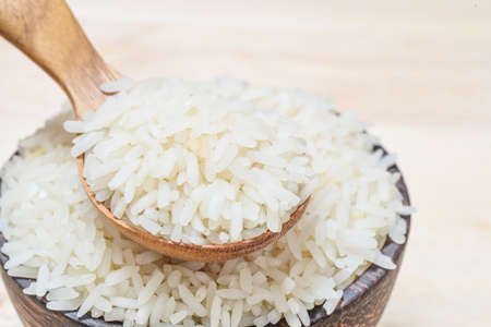 wood agricultural: close-up of jasmine rice on wooden spoon