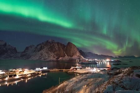 Northern lights over the Hamnoy village at night in winter season, Lofoten islands, Norway, Europe