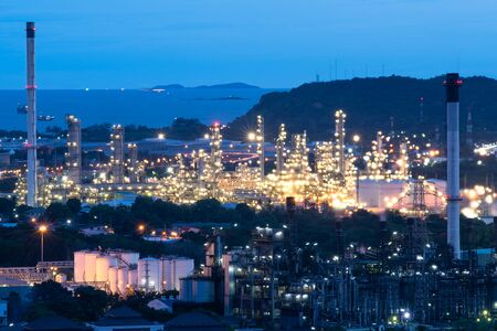 pipelines and towers of oil and gas refinery petrochemical factory at night, petroleum and chemical plant