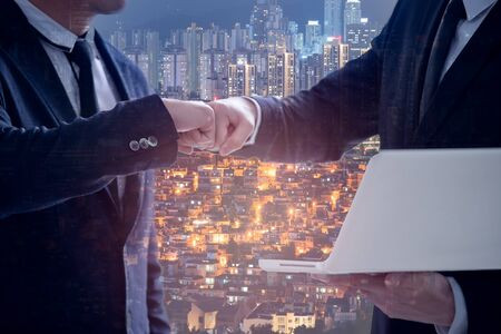 Businessman in suits giving fist bump at the office, Power of cooperation and business success team concept