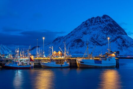 Harbor with fishing boats at twilight in winter season, Lofoten islands, Norway, Europe Stockfoto