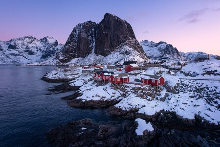Fishermen's cabins (rorbu) in the Hamnoy village at sunrise in winter season, Lofoten islands, Norway, Europe