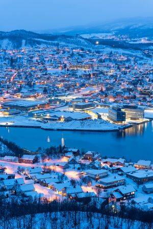Aerial view of Harstad city the small harbour of Norwegian at twilight in winter season, Norway, Europe