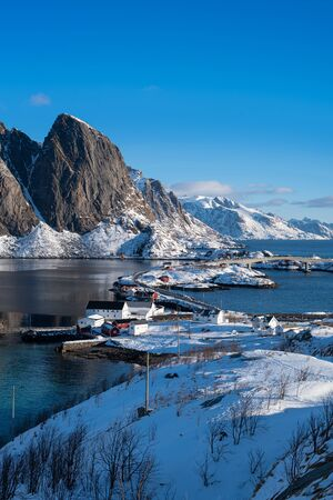 Fishermen's cabins (rorbu) in the Hamnoy village under blue sky in winter season, Lofoten islands, Norway, Europe