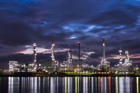 Pipelines and towers of oil and gas refinery petrochemical factory at night, petroleum and chemical plant Reklamní fotografie