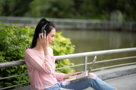 Portrait of Young Asian woman enjoy listening to music with headphones, happy and relaxing time Zdjęcie Seryjne