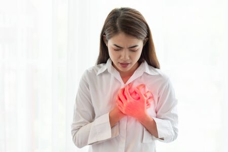 Unhealthy asian woman having heart attack while hands touching her chest, Healthcare and medical concept Reklamní fotografie
