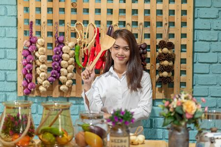 Portrait of young Asian woman cooking in the kitchen, Healthy eating lifestyle concept