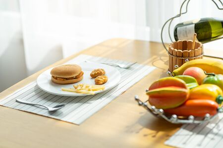Delicious hamburger with french fries on the table, junk food concept Stockfoto