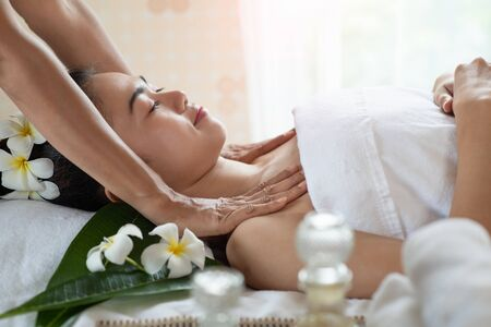 Young Asian woman getting massage in the spa salon, enjoying and relaxing, Healthy concept