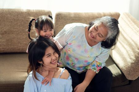 Happy Asian family having fun in their house, love and happiness people concept with home