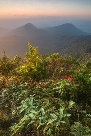 Rising sun over the mountains in early morning, Natural summer landscape, San Dan peak, Khlong Naka Wildlife Sanctuary, Ranong, Thailand, Asia