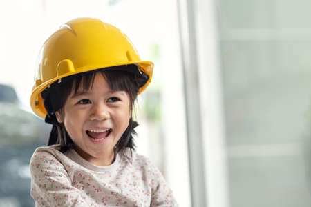 Young Asian child engineer wearing helmet, education and occupation concept