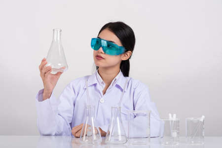 Young Asian women scientist with test tube making research in clinical laboratory, Science and chemistry concept, Medical technologist