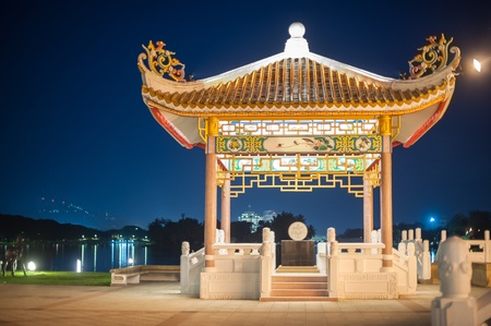 Chinese pavilion sculpture  in public park Nakhon Sawan province,Thailand  at night. photo