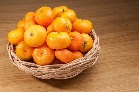 Orange fruite with basket on wood table photo