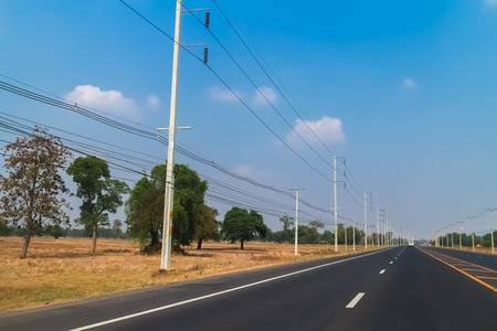 telegraphs: row of wire pole inside road on countryside Stock Photo