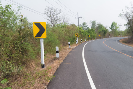 trip hazard sign: Right Turn Sign: Road signs warn of a sharp turn on a narrow road Stock Photo