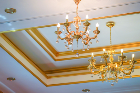 Simple and minimize chandelier gold colour on the ceiling