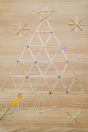Arranged match to Merry Christma word, and Christmas tree. Stock Photo