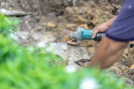 gardener whet the shovel for sharpening more. Фото со стока