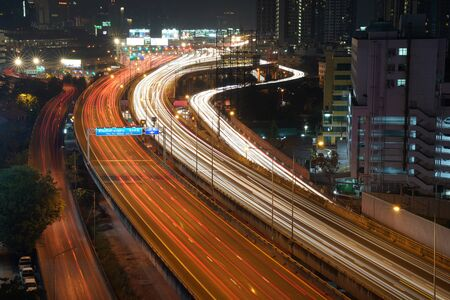 BANGKOK, THAILAND - 10 December, 2017: Cityscape; flowing traffic situation on Sirat express way in Sunday night. Shooting with low speed shutter.