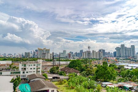 Bangkok, Thailand - 13 Sep, 2018: Bangkok cityscape at Ratchada Area with building and construction zone all around in the day that open sky.