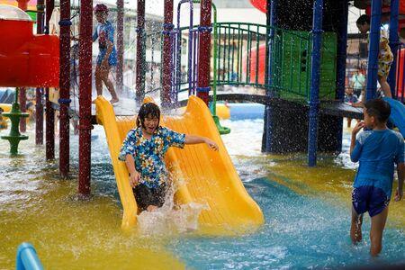 BANGKOK, THAILAND - 13 Apr, 2018: Kids are playing in mini holiday water themepark at Mega Bangna Department store. Editorial