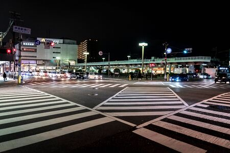 Sakaihigashi, Osaka, Japan - 28 Feb 2018, A lot of car in line was wating for traffic light and crownd walked trough at the juction and zebra line.