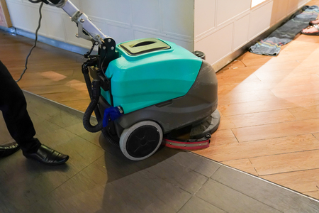 floor cleaning machine was worked by worker and house keeping, in the foodcourt of departmentstore. Banco de Imagens