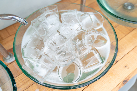 a lot of a glass of water glass in the glass sink ready for washing and clean.