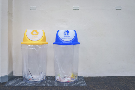 blue general waste cover and yellow recycle cover transparence trash in the airport, Thailand.