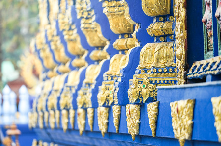 Blue Gold Asian pole Thai pattern style beside of temple wall., North of Thailand. Standard-Bild - 124438332