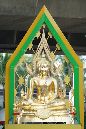 gold buddha statue with artifact green aura behind.
