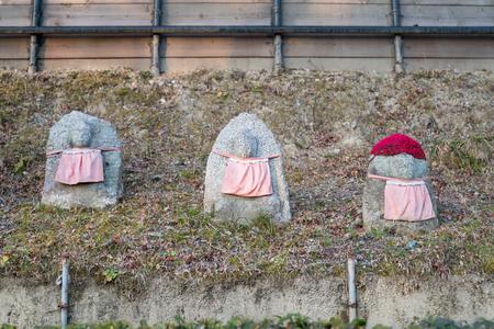 Three Buddha stone statue at kiyomizu-dara, Japan.