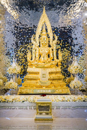 gold buddha statue front of luxury background.