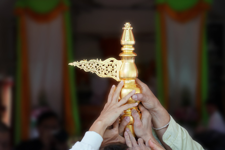 united people; close up their hands, rise up the holy gold top of the temple decoration together in religion local traditional ceremony.