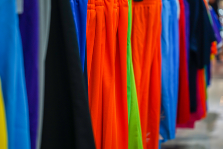 sportswear hang on th the Clothesline in the sport shop. Stock fotó