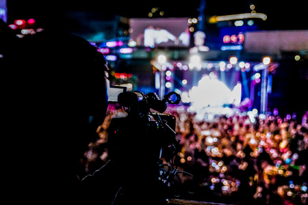 silhouette videographer had been recorded to blurred and bokeh countdown concert., Bangkok, Thailand. 写真素材