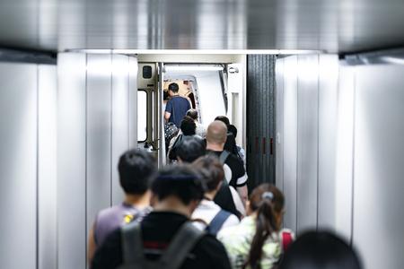 travelers, passenger walk into aircraft plane via tubeline dock, inside the walkway. Imagens