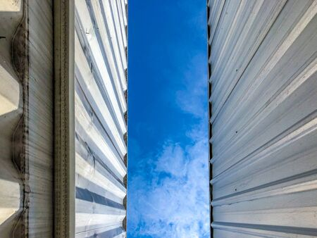 Metal sheet pattern with the blue sky in the middle. 写真素材