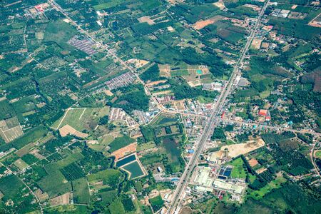 the view of green field and farm and city downtown in middle of Thailand. It shot from Jetplane. Foto de archivo - 132110140